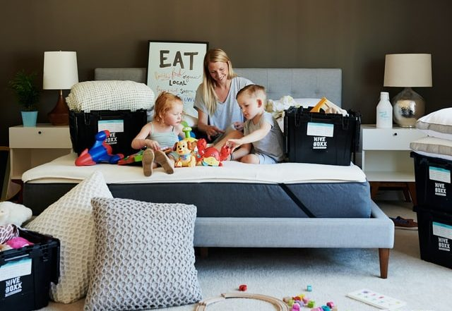 Family surrounded by toys and storage boxes